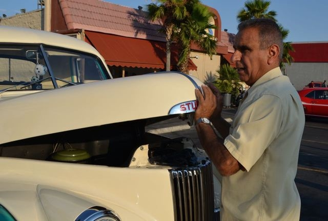Michael Gevargiz closes the hood of his 1947 Studebaker truck during a car night at Mr. D's sports bar and grill, 1810 S. Rainbow Blvd. The event takes place at 6 p.m. every Tuesday. (Ginger Meu ...