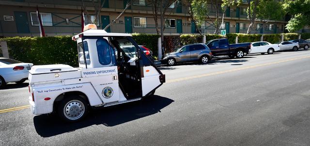 Parking enforcement officer Joshua Kuykendall patrols along Seventh Street in downtown Las Vegas on Friday, June 12, 2015. (David Becker/Las Vegas Review-Journal)
