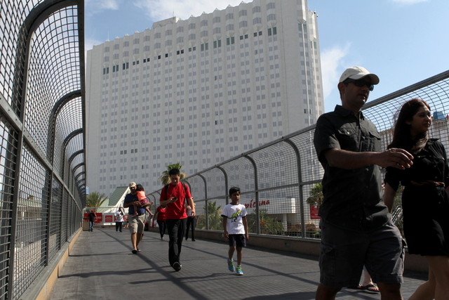 Pedestrians use a bridge over Tropicana Avenue on Wednesday, July 1, 2015, in North Las Vegas. The four pedestrian bridges at the corner of Las Vegas Boulevard and Tropicana Avenue. (James Tensuan ...