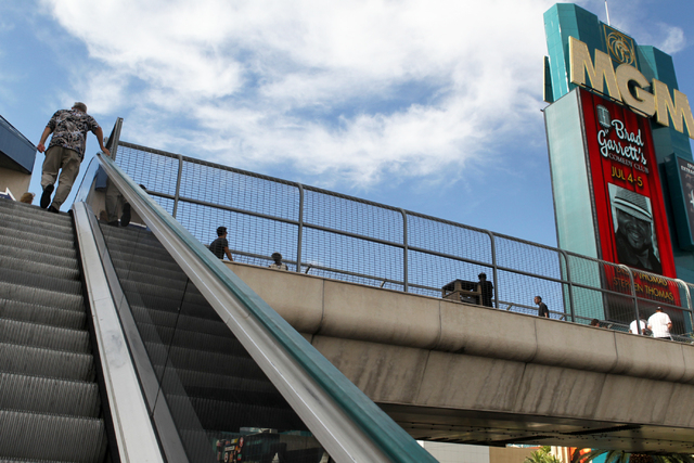 A pedestrian makes his way up to a bridge over Las Vegas Boulevard on Wednesday, July 1, 2015, in North Las Vegas. The four pedestrian bridges at the corner of Las Vegas Boulevard and Tropicana Av ...