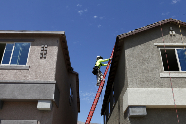 A construction worker climbs to the top of a roof at Adaven Homes on Wednesday, July 1, 2015, in North Las Vegas. This past June was the hottest on record. (James Tensuan/Las Vegas-Review Journal) ...