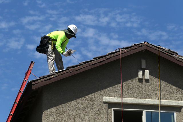 A roofer lays down tiles at Adaven Homes on Wednesday, July 1, 2015, in North Las Vegas. This past June was the hottest on record. (James Tensuan/Las Vegas-Review Journal) Follow James Tensuan on  ...