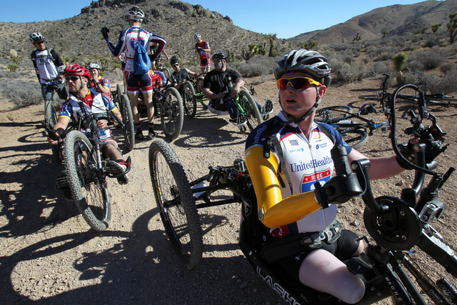 Tim Brown, a Marine who lost three limbs after stepping on an improvised explosive device in Afghanistan in 2011, leads a group of injured veterans through Red Rock Canyon near Blue Diamond during ...
