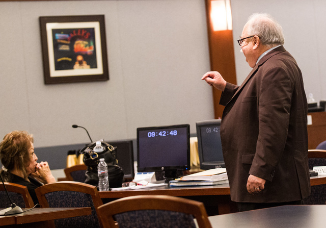 Defense lawyer Tom Pitaro, right, points to former Clark County School District official Priscilla Rocha during sentencing at the Regional Justice Center in Las Vegas on Wednesday, July 1, 2015. R ...