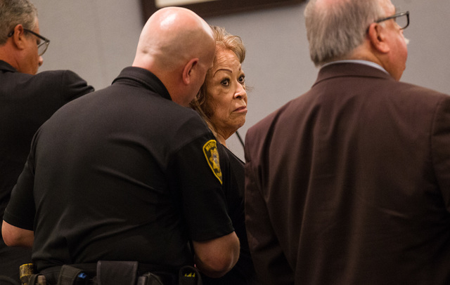 Former Clark County School District official Priscilla Rocha is handcuffed after being sentenced four to 10 years in prison for stealing tens of thousands of dollars from the district, at the Regi ...