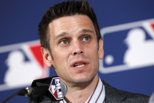 Los Angeles Angels of Anaheim general manager Jerry Dipoto answers questions about the signing of Albert Pujols and pitcher C.J. Wilson during a news conference at the MLB Winter Meetings in Dalla ...
