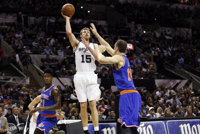 Dec 10, 2014; San Antonio, TX, USA; San Antonio Spurs power forward Matt Bonner (15) shoots the ball over New York Knicks center Jason Smith (14) during the first half at AT&T Center. (Soobum Im-U ...