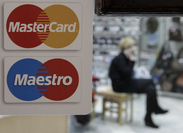 A sign with a logo of MasterCard is seen on the door of a shoe shop in Stavropol January 13, 2015. International credit and debit card company MasterCard has agreed to transfer card processing ins ...