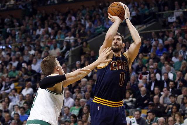Apr 23, 2015; Boston, MA, USA; Cleveland Cavaliers forward Kevin Love (0) shoots against Boston Celtics forward Jonas Jerebko (8) during the second half in game three of the first round of the NBA ...