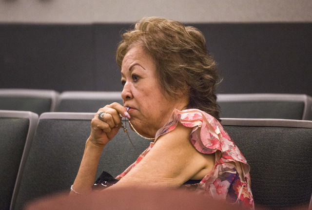 Priscilla Rocha holds a charm during her arraignment at Regional Justice Center on Wednesday, July 30, 2014.  Rocha and four of her co-defendants  are charged with a total of 52 counts related to  ...