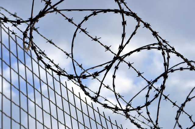 Prison fence (Thinkstock)