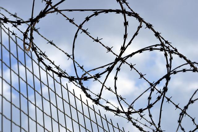 Prison fence. (Thinkstock)