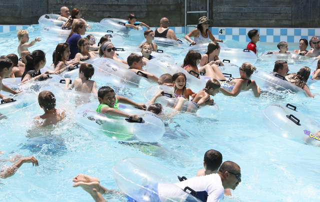 Swimmers play on a hot day at Surf-A-Rama Wave Pool at Cowabunga Bay Water Park in Henderson, Saturday, June 27, 2015. An excessive heat warning will be in effect until 9 p.m. as temperatures are  ...