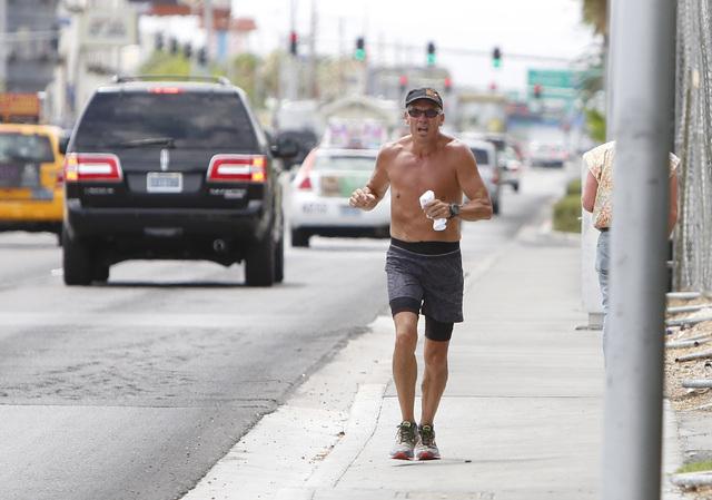 A man jogs on a cloudy day on Paradise Rd. near Howard Hughes Pkwy., on Thursday, July 9, 2015. (Bizuayehu Tesfaye/Las Vegas Review-Journal) Follow Bizu Tesfaye on Twitter @bizutesfaye
