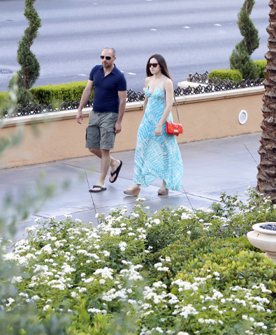 Tourists walk along the Strip near the Palazzo hotel-casino Friday, July 10, 2015. After a week of cooler temperatures in Las Vegas, things will start to heat up again by the end of the weekend.   ...