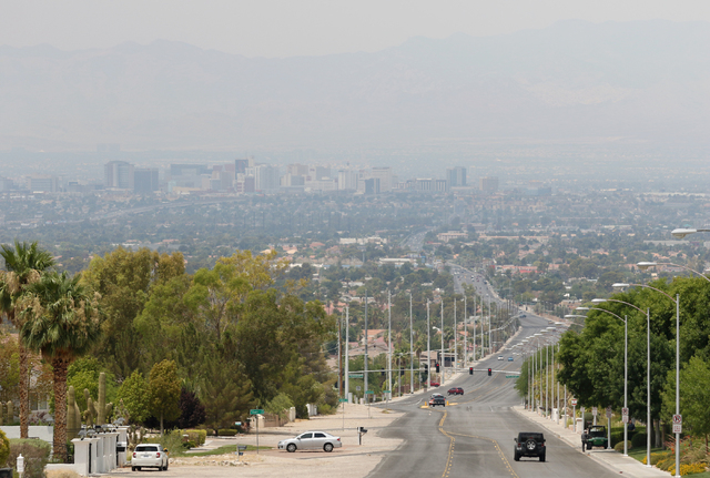 Haze is seen from the base of Frenchman Mountain covering the valley and downtown Las Vegas Friday, June 26, 2015. Las Vegas was under a Clark County Department of Air Qualityճ ozone advisor ...