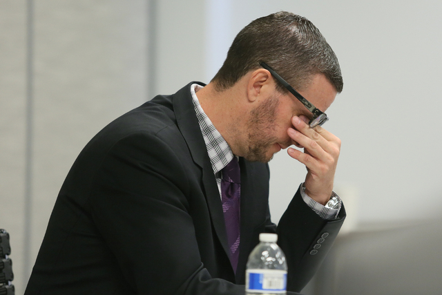 Suspended defense lawyer Brian Bloomfield is overcome with emotion as he appears in front of a State Bar of Nevada disciplinary panel Friday, June 19, 2015, in Las Vegas. Bloomfield pleaded guilty ...