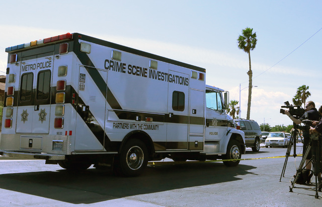 Metro police department's Crime Scene Investigation van arrives at the house where two people were wounded in a northwest valley shooting on Thursday, May 7, 2015 at the 5800 block of Westport Cir ...