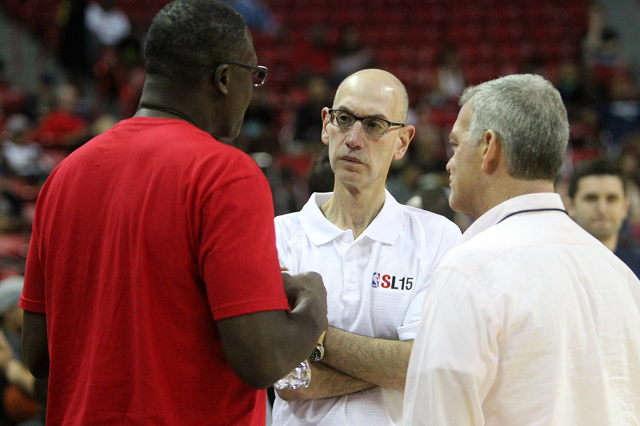 NBA Commissioner Adam Silver talks to retired NBA Player Dominique Wilkins, left, and Tony Ressler at the Cox Pavilion on Sunday, July 12, 2015. The NBA Summer League runs through July 20.