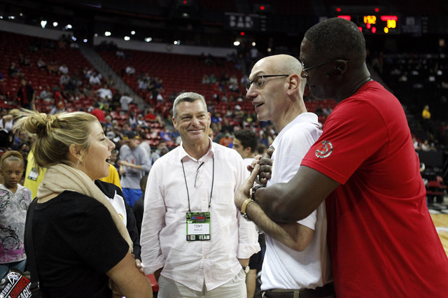 Retired NBA Basketball Player Dominique Wilkins hugs NBA Commissioner Adam Silver at the Cox Pavilion on Sunday, July 12, 2015. The NBA Summer League runs through July 20.