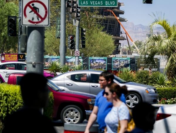 Pedestrians walk along Las Vegas Boulevard across the street from New York-New York on July 23. JEFF SCHEID/LAS VEGAS REVIEW-JOURNAL FOLLOW HIM