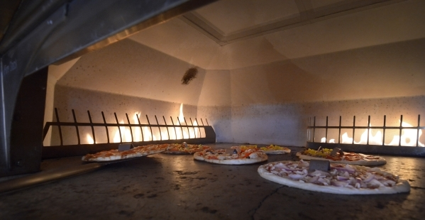 Pizzas are shown cooking in the oven at Blaze Pizza in Henderson . (Bill Hughes/Las Vegas Review-Journal)