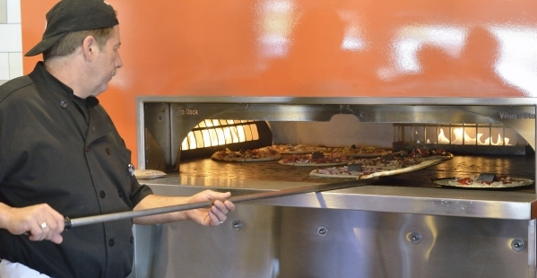 Pizza smith John LaRocca cooks pies in the oven at Blaze Pizza. (Bill Hughes/Las Vegas Review-Journal)