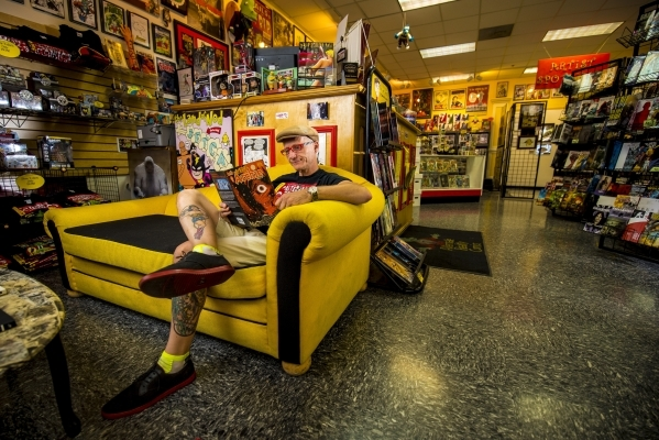 Ralph Mathieu, owner of Alternate Reality Comics, browses through a comic in his store on Maryland Parkway. Mathieu says print and digital comics are coexisting in the valley.   Joshua Dahl/Las Ve ...