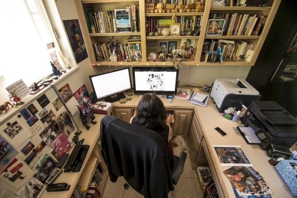 "Deborah Daughetee reviews artwork for her ""Gates of Midnight"" comic at her home office in Las Vegas. She owns Kymera Press and offers her stories in both print and digital versions.   Jo ..."