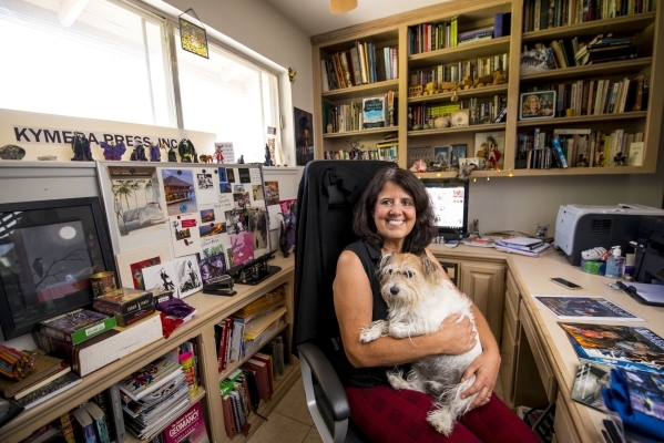 "Deborah Daughetee's dog, Max, is a frequent companion in her home office, where she creates the ""Gates of Midnight"" series under the name Debbie Lynn Smith.   Joshua Dahl/Las Vegas ..."