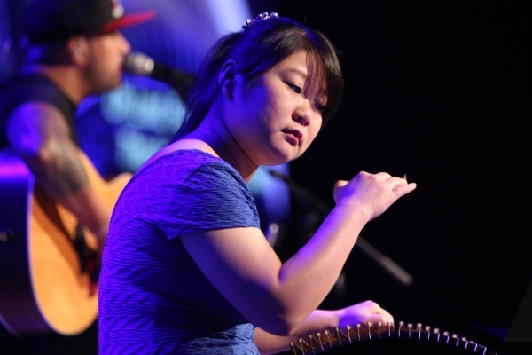 """Guest performer Yun """"Celine"""" Peng concentrates on her music during an Art Effect service at The Crossing Church. The summer program incoporated local artists into the worship service. (E ..."""