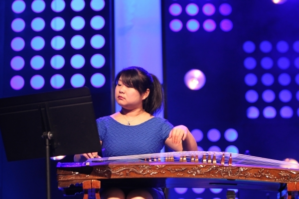 """Special guest performer Yun """"Celine"""" Peng plays music using a guzheng, a Chinese instrument, during a recent Sunday service at The Crossing Church in Las Vegas. (Erik Verduzco/Las Vegas  ..."""