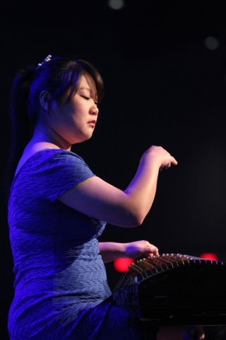 """Special guest performer Yun """"Celine"""" Peng plays music using a guzheng, a Chinese instrument, during the Art Effect series at The Crossing Church. (Erik Verduzco/Las Vegas Review-Journal) ..."""