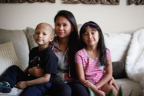 Camille de Leon holds son Anthony and daughter Rosie at the Ronald McDonald House in Las Vegas. Ronald McDonald House gives the Reno family a homelike place to stay as  Anthony undergoes medical t ...