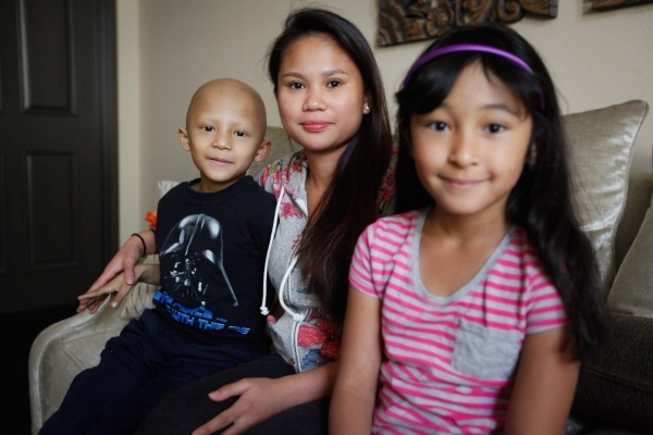 Camille de Leon sits with son Anthony and daughter Rosie at the Ronald McDonald House in Las Vegas. The Reno family has been living in the home since March, after Anthony was diagnosed with a rare ...
