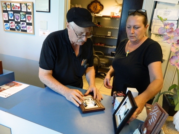 Allen Silberstein, owner of Compassionate Pet Cremation, 401 Mark Leany Drive, and office manager Elisabeth Loring talk about the plaques that serve as mementos for customers. They include each pe ...