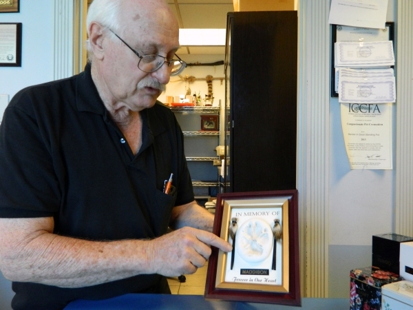Allen Silberstein, owner of Compassionate Pet Cremation, talks about the plaques that serve as mementos for customers. The plaques include each pet's paw print, locks of their hair and their ...