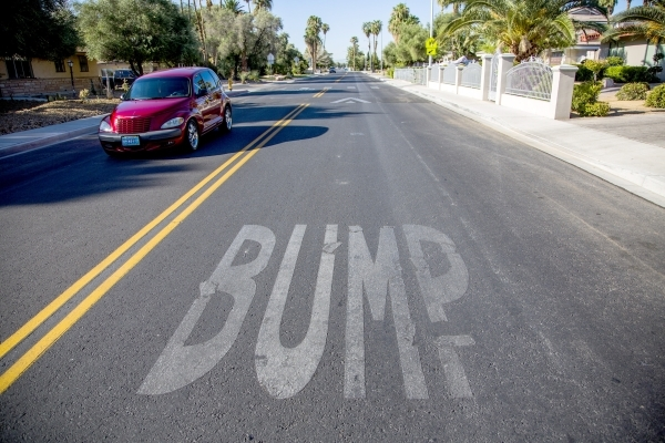 Lettering indicating a speed bump is seen July 22 on Sixth Street and Sweeney Avenue a short distance from Las Vegas City Councilman Bob Coffin's home.   JEFF SCHEID/LAS VEGAS REVIEW-JOURNAL ...