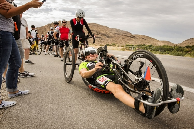 Handcyclist Chris Sprouls waits for the start of the Nevada Police Athletic Federation bicycle race Thursday, July 30, 2015, on State Route 159 near Blue Diamond. Sprouls is trying to earn a spot  ...