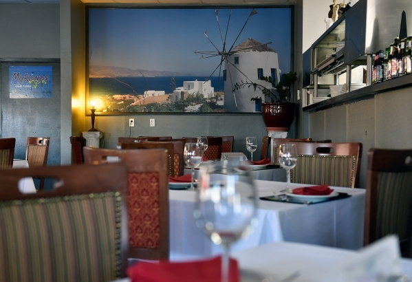 Table settings with large images of Greek islands are displayed at Mykonos Greek Cuisine. (David Becker/View)