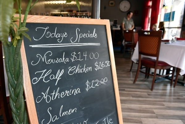 The specials board is seen at Mykonos Greek Cuisine July 27 in Sun City Summerlin. (David Becker/View)