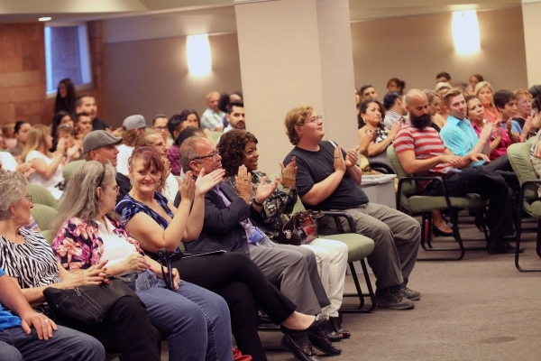People clap during a graduation ceremony for participants of specialty court programs at the Regional Justice Center in Las Vegas on Friday, July 24, 2015. (Chase Stevens/Las Vegas Review-Journal) ...