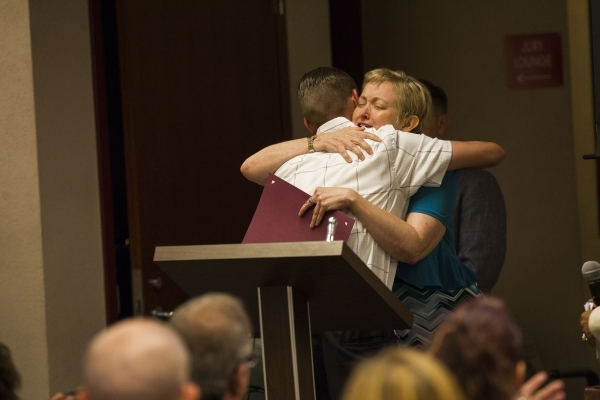 Scott Dyer of the mental health court program hugs Judge Linda Marie Bell during a graduation ceremony for participants of specialty court programs at the Regional Justice Center in Las Vegas on F ...