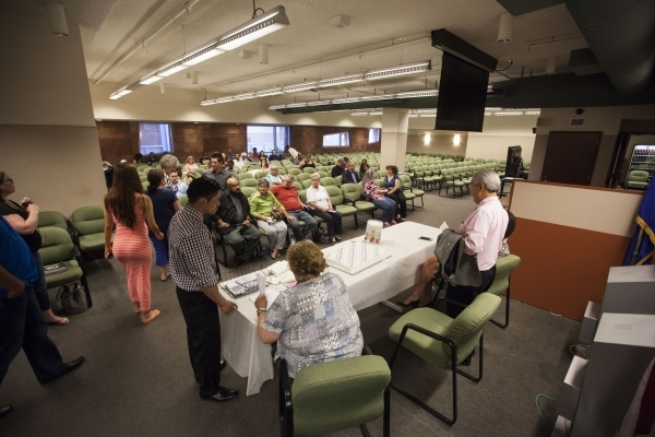 People check in before the start of a graduation ceremony for participants of specialty court programs at the Regional Justice Center in Las Vegas on Friday, July 24, 2015. (Chase Stevens/Las Vega ...