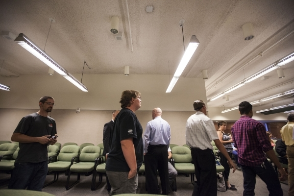 People line up to check in before the start of a graduation ceremony for participants of specialty court programs at the Regional Justice Center in Las Vegas on Friday, July 24, 2015. (Chase Steve ...