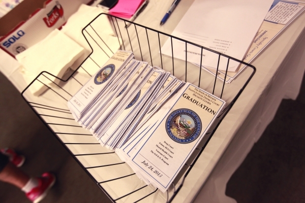 Pamphlets are seen before the start of a graduation ceremony for participants of specialty court programs at the Regional Justice Center in Las Vegas on Friday, July 24, 2015. (Chase Stevens/Las V ...