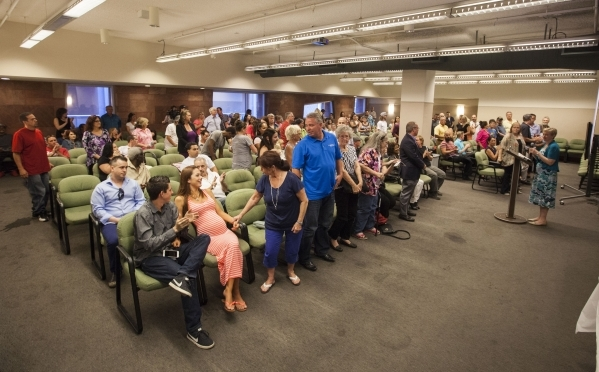 Supporters stand up at the start of a graduation ceremony for participants of specialty court programs at the Regional Justice Center in Las Vegas on Friday, July 24, 2015. (Chase Stevens/Las Vega ...