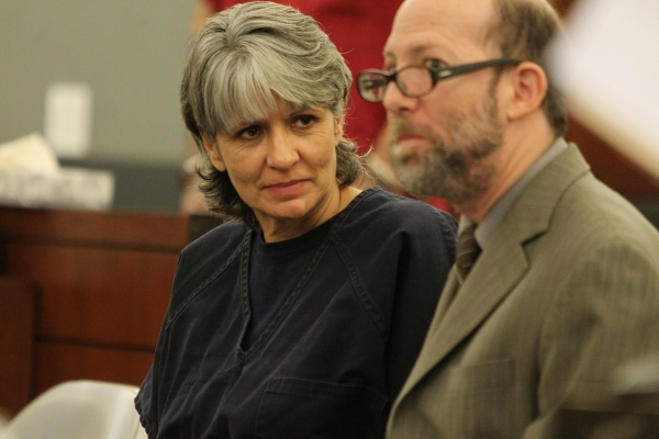 Jerry Meador, left, convicted of theft charges, speaks to her attorney Dayvid Figler during her court hearing for an opportunity to participate in a rarely used diversion for problem gamblers at t ...