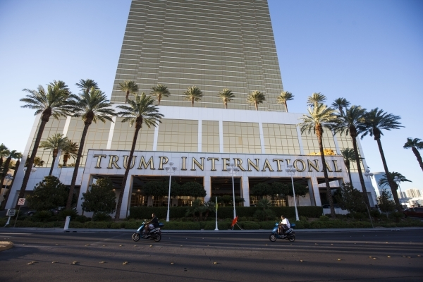 People on mopeds pass by the Trump International Hotel in Las Vegas on Friday, July 24, 2015. (Chase Stevens/Las Vegas Review-Journal) Follow Chase Stevens on Twitter