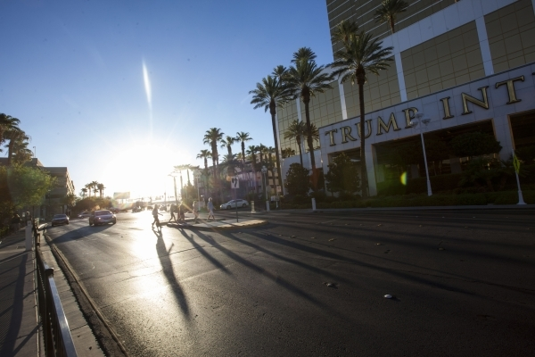Pedestrians cross the road outside of The Trump International Hotel in Las Vegas on Friday, July 24, 2015. (Chase Stevens/Las Vegas Review-Journal) Follow Chase Stevens on Twitter